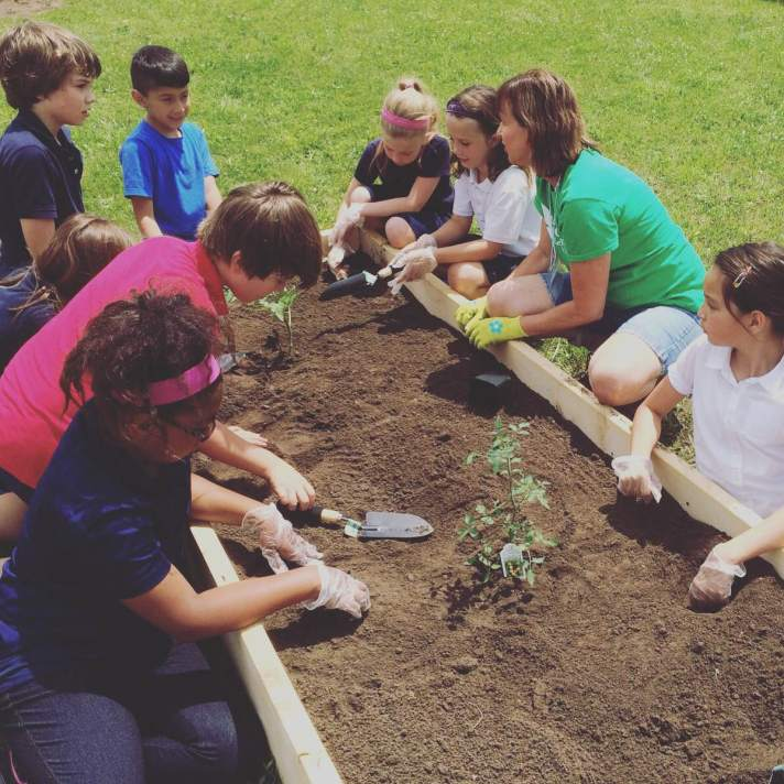 Kids building a garden at their school in St. Catharines